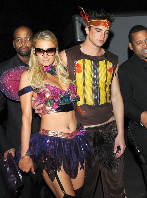 Celebrities attending the Playboy Mansion Halloween Party in Beverly Hills, California on October 27th, 2012. Pictured: Paris Hilton, River Viiperi. (Photo by FameFlynet)