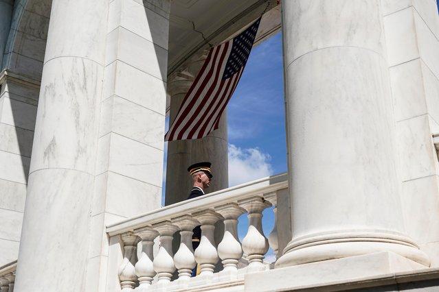 A soldier watches as U.S. President Joe Biden speaks at Arlington National Cemetery during Memorial Day in Arlington, Virginia, U.S. May 31, 2021. (Photo by Joshua Roberts/Reuters)