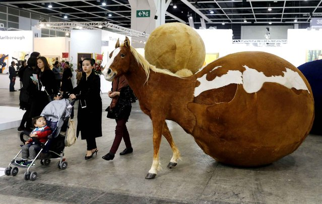 "An artwork ""THEY are coming to Hong Kong"" created by Chinese artist Yang Maoyuan, is displayed during the VIP preview of the art fair Art Basel in Hong Kong Friday, March 13, 2015. (Photo by Kin Cheung/AP Photo)"