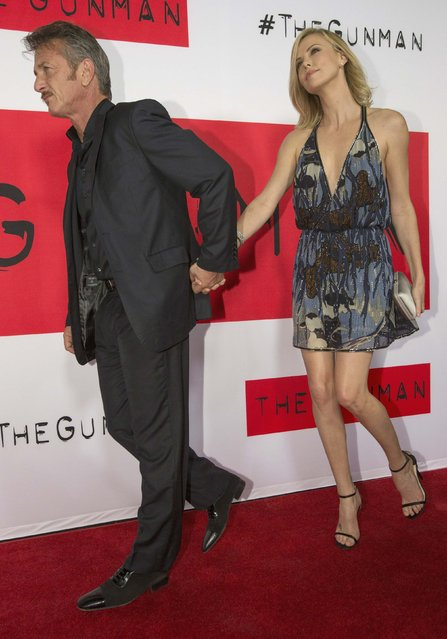 """Cast member Sean Penn and actress Charlize Theron arrive at the premiere of """"The Gunman"""" in Los Angeles, California March 12, 2015. The movie opens in the U.S. on March 20. (Photo by Mario Anzuoni/Reuters)"""