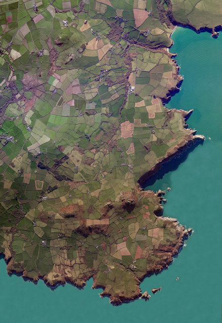 "Pembrokeshire 52°00'52.2""N, 5°05'14.0""W. Pembrokeshire is a county in the south-west of Wales. The area is home to Pembrokeshire Coast national park, which includes a 186-mile walking trail known as the Pembrokeshire Coast Path. In the north of the county are the Preseli Hills, a swathe of high moorland with many prehistoric sites and the probable source of the bluestones that were used in the construction of Stonehenge in England. (Photo by Daily Overview/DigitalGlobe, a Maxar Company)"
