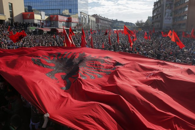 Supporters of the Kosovo opposition political parties wave a giant Albanian national flag during a protest  in Pristina, Kosovo, 17 February 2016. Tens of thousands of opposition supporters gathered in a protest demanding the resignation of Kosovo's government after agreements that has been reached in Brussels during the EU-brokered dialogue between Kosovo and Serbia. (Photo by Valdrin Xhemaj/EPA)