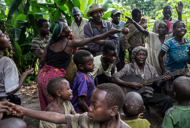 People sing and dance at Kagorwa Pygmy camp on Idjwi island in the Democratic Republic of Congo, May 18, 2016. (Photo by Therese Di Campo/Reuters)