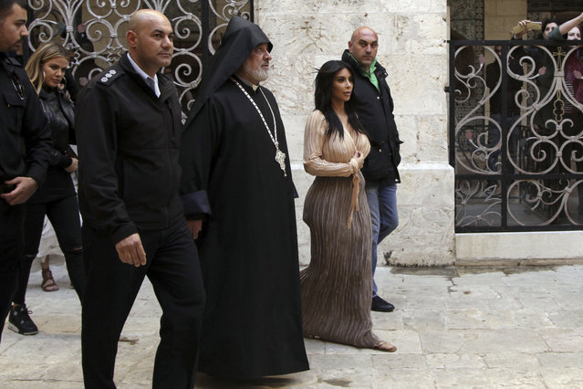 Kim Kardashian, a US reality TV star walks inside Armenian St. James Cathedral in Jerusalem Monday, April 13, 2015. Kim Kardashian, along with husband West, their daughter, North West, and her sister, Khloe, arrived to Israel on a private visit. (Photo by Mahmoud Illean/AP Photo)