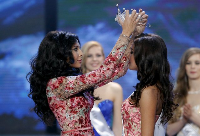 "Sofia Nikitchuk (R) from Yekaterinburg is crowned by Miss Russia 2014 Yulia Alipova after winning the annual national ""Miss Russia"" beauty pageant at the Barvikha Luxury Village Concert Hall outside Moscow April 18, 2015. The contest has exclusive rights to represent Russia at ""Miss World"" and ""Miss Universe"" beauty pageants, according to the official website. (Photo by Maxim Shemetov/Reuters)"