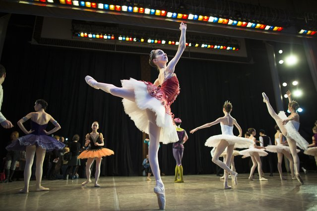 In this photo taken on Thursday, March  3, 2016, Harper Ortlieb, from Mount Hood, Oregon, warms up for a performance at the Bolshoi Ballet Academy in Moscow, Russia. (Photo by Alexander Zemlianichenko/AP Photo)