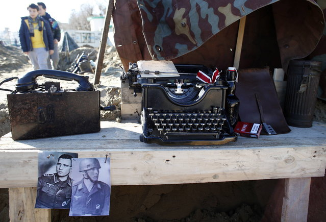 An old typewriter and telephone are seen at the German Army trench during the re-enactment of a World War Two landing to mark its 70th anniversary in Anzio, near Rome, January 25, 2014. (Photo by Stefano Rellandini/Reuters)