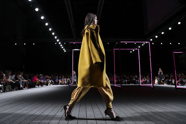 A model displays a creation by Portuguese designer Carlos Gil on the second day of the Lisbon Fashion Week, at the Carlos Lopes Pavillion in Lisbon, Portugal, 09 March 2019. (Photo by Miguel A. Lopes/EPA/EFE)