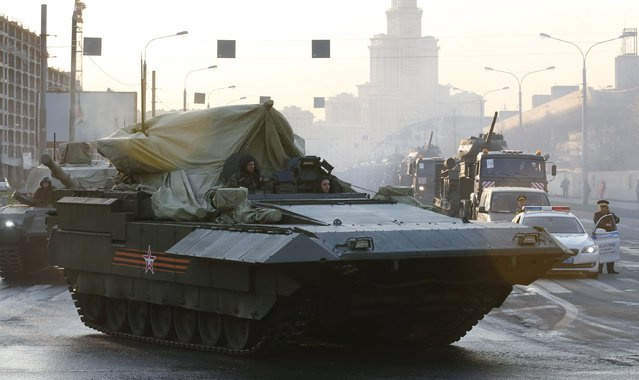 A partially covered T-15 heavy infantry fighting vehicle (IFV) drives along a street before a rehearsal for the Victory Day parade in Moscow, Russia, April 29, 2015. (Photo by Maxim Zmeyev/Reuters)