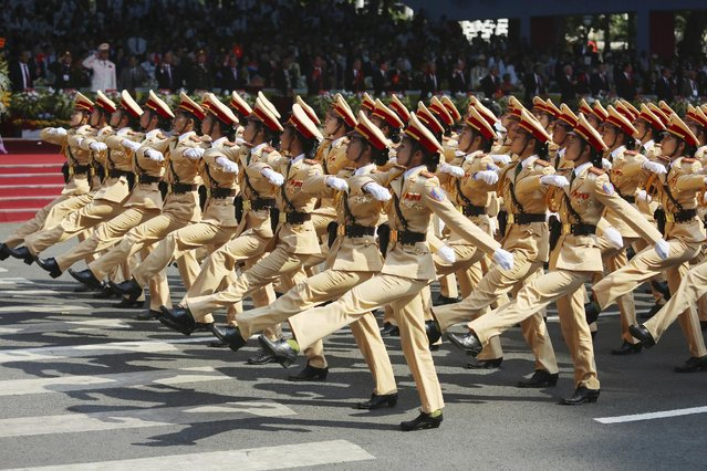 A group of Vietnamese traffic policewomen take part in a parade celebrating the 40th anniversary of the end of the Vietnam War which is also remembered as the fall of Saigon, in Ho Chi Minh City, Vietnam, Thursday, April 30, 2015. (Photo by Na Son Nguyen/AP Photo)