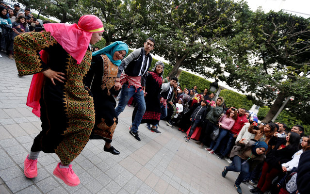Tunisian dancers perform the Dabke, a Palestinian traditional dance, on Habib Bourguiba Avenue in Tunis, Tunisia February 4, 2017. (Photo by Zoubeir Souissi/Reuters)