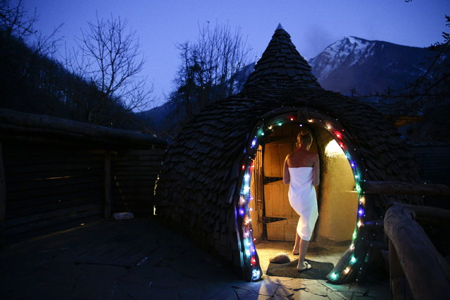 Olga Gharkova enters a aromatherapy room at the British Banya bathhouse, Saturday, February 15, 2014, in Krasnaya Polyana, Russia, just a few miles away from the ski slopes where athletes are competing for Olympic medals. (Photo by Jae C. Hong/Associated Press)