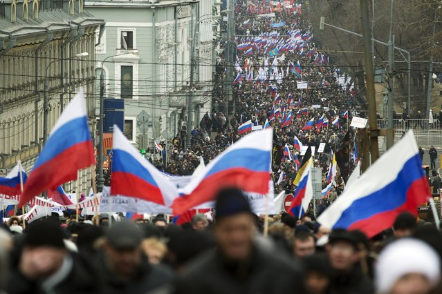 More than ten thousand pro-Kremlin demonstrators many holding Russian flags march in central Moscow, Russia, Sunday, March 2, 2014 to express support for the latest developments in Russian-Ukrainian relations. (Photo by Pavel Golovkin/AP Photo)