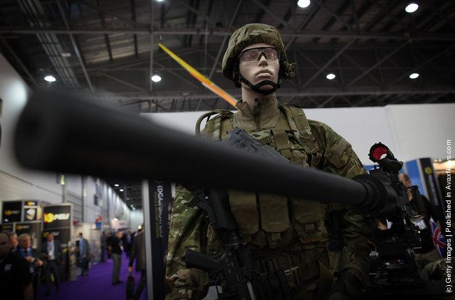 Uniforms and weapons are displayed at the Defence and Security Exhibition
