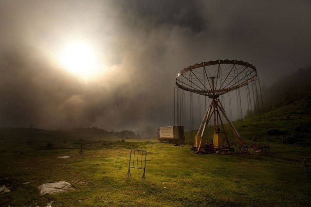 """Carousel in the mist""; Prokoshko, Bosnia. (Photo by Marko Stamatovic/PA Wire)"