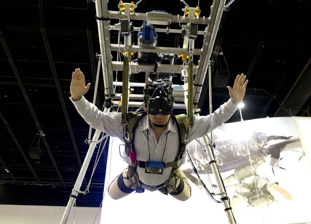 Tom Ito, of Blue Aerospace & Heico company, takes part in a parachute simulator at the 2015 Special Operations Forces Industry Conference at the Tampa Convention Center on Tuesday, May 19, 2015. (Photo by Michael Bou-Nacklie/The Tampa Bay Times via AP Photo)