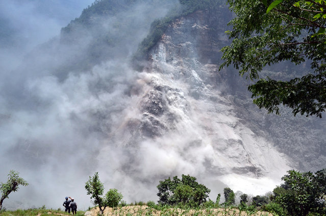 This handout photograph released by the Nepal Army on May 24, 2015, shows an area in Nepal's mountainous northwest Myagdi district affected by a landslide. Thousands of panic-stricken villagers fled their homes fearing flash floods after an overnight landslide blocked a river in quake-hit Nepal's northwest, officials said May 24. (Photo by AFP Photo/Nepal Army)