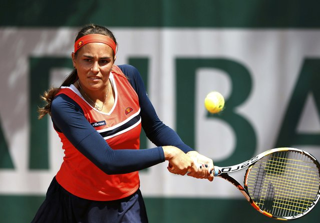 Monica Puig of Puerto Rico plays a shot to Sabine Lisicki of Germany during their women's singles match at the French Open tennis tournament at the Roland Garros stadium in Paris, France, May 25, 2015. (Photo by Pascal Rossignol/Reuters)