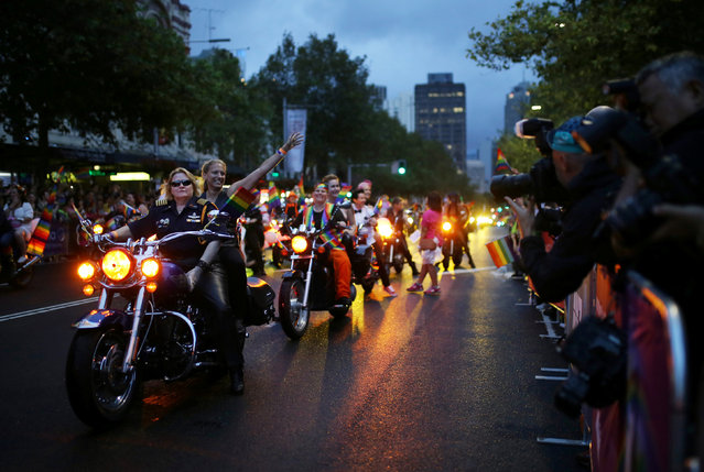 """Motorcyclists from """"Dykes on Bikes"""" lead the parade  during the annual Sydney Gay and Lesbian Mardi Gras festival in Sydney, Australia March 4, 2017. (Photo by Steven Saphore/Reuters)"""