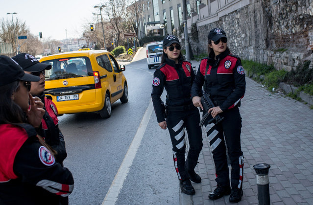 Female police officers from Istanbul's Motorcycled Police Unit wait to search vehicles during a roadside checkpoint operation on March 7, 2017 in Istanbul, Turkey. The rapid response unit nicknamed Dolphins is used primarily in crime prevention operations and has 25 female officers. 6% of Turkey's 250,000 strong police force are women, March 8 marks International Women's Day. (Photo by Chris McGrath/Getty Images)