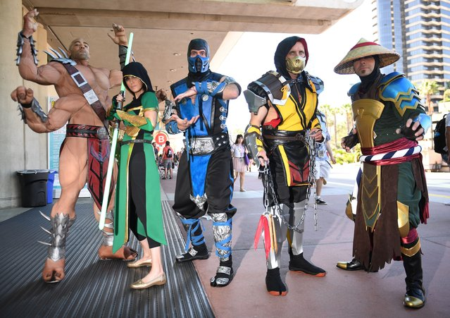 "Cosplayers portraying characters from ""Mortal Kombat"" attend the 2019 Comic-Con International on July 18, 2019 in San Diego, California. (Photo by Robyn Beck/AFP Photo)"
