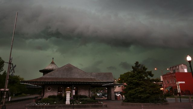 Storms clouds form above the Amtrak Station in Kirkwood, Mo., Tuesday, April 26, 2016. (Photo by Robert Cohen/St. Louis Post-Dispatch via AP Photo)