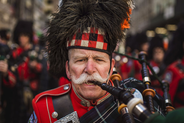 Bagpipers march up  Fifth Avenue during the St. Patrick's Day Parade, Friday, March 17, 2017, in New York. New York City was awash in green and Irish pride as throngs celebrated at the annual parade. (Photo by Andres Kudacki/AP Photo)