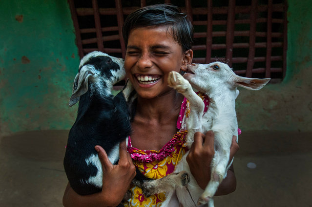 A girl plays with her pet goats at a village some 200 kilometers away from Kolkata, in Tumpa Mondal, India on July 21, 2019. (Photo by Tumpa Mondal/Xinhua News Agency/Barcroft Media)