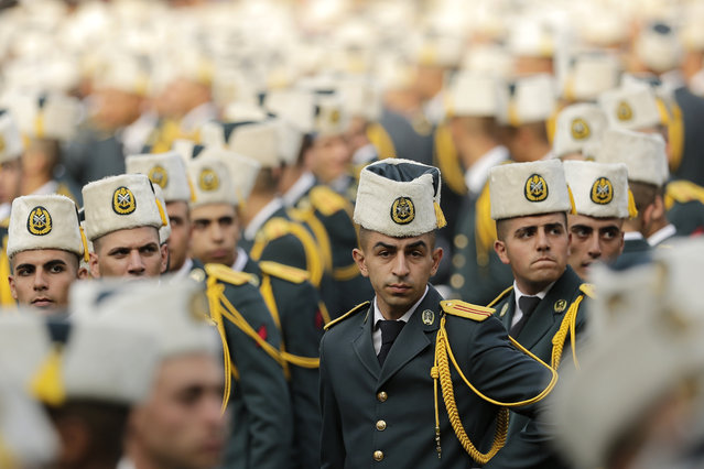 Lebanese officers attend a graduation ceremony marking the 74th Army Day, at a military barracks in Beirut's suburb of Fayadiyeh, Lebanon, Thursday, August 1, 2019. (Photo by Hassan Ammar/AP Photo)
