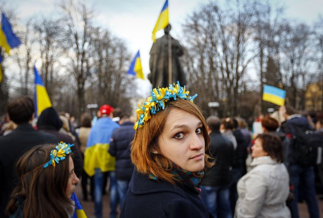 A woman wearing a national flower crown looks back as she attends a pro-Ukrainian rally in Luhansk, eastern Ukraine April 15, 2014. (Photo by Shamil Zhumatov/Reuters)