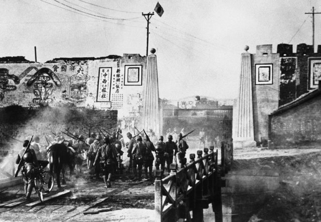 In this September 23, 1942 file photo, Japanese troops advance towards Nanking, China. The relationship between China and Japan is one of close economic ties shadowed by enduring political tensions dating to Japan's brutal World War II invasion and occupation of parts of China. Relations sunk to their lowest level in years following Japan's 2012 move to nationalize East China Sea islands claimed by China, setting off anti-Japanese riots in China. (Photo by AP Photo)