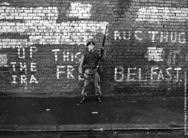 1971:  An armed British soldier on patrol in Belfast