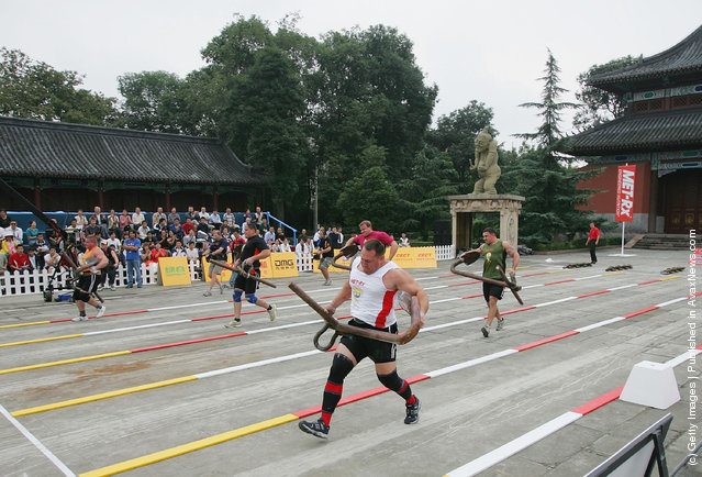 Contestants carry anchors during a match of the 2005 World's Strongest Man Competition at Wuhou Temple