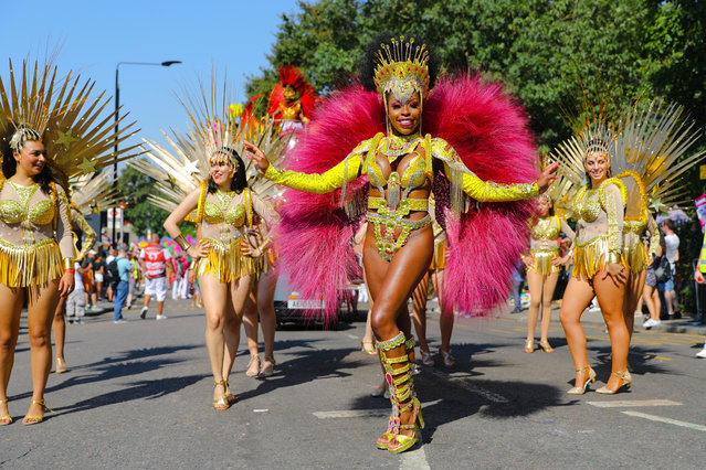 Dancers at the Notting Hill Carnival Adults Parade in London, Britain, 26 August 2019. The Notting Hill Carnival is the largest street carnival in Europe, with more than a million people expected to attend the two-day celebration of Caribbean heritage on 25 and 26 August. (Photo by Vickie Flores/EPA/EFE)