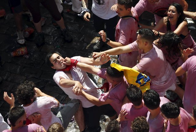 A reveller is punched in the face by another reveller during the start of the San Fermin Festival in Pamplona, Spain, July 6, 2015. (Photo by Susana Vera/Reuters)