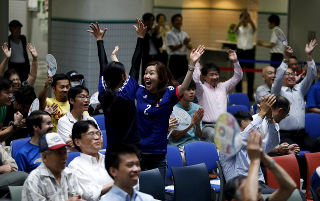 Japan's soccer fans celebrate a goal by Japan's Aya Miyama against England during their FIFA Women's World Cup semi-final soccer match, at a public viewing event in Tokyo, Japan, July 2, 2015. (Photo by Yuya Shino/Reuters)