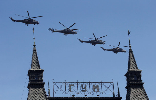 Russian Mi-35 military helicopters fly in formation during the Victory Day parade, marking the 71st anniversary of the victory over Nazi Germany in World War Two, above GUM department store at Red Square in Moscow, Russia, May 9, 2016. (Photo by Grigory Dukor/Reuters)