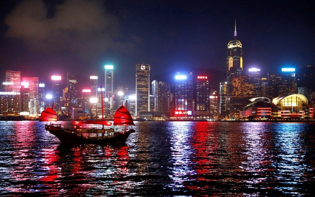 A junk boat passes the skyline as seen from the Tsim Sha Tsui waterfront in Hong Kong, China, August 27, 2019. (Photo by Kai Pfaffenbach/Reuters)