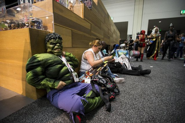 A cosplay enthusiast dressed like the character of The Hulk waits during the 2015 Comic-Con International Convention in San Diego, California July 10, 2015. (Photo by Mario Anzuoni/Reuters)