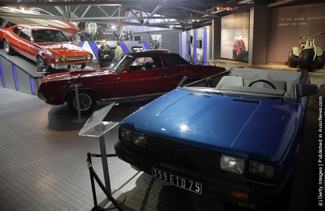 People look at cars, including a roofless Renault 11 TXE  that was used in the 1985 James Bond film A View To a Kill, currently displayed at the Bond In Motion exhibition