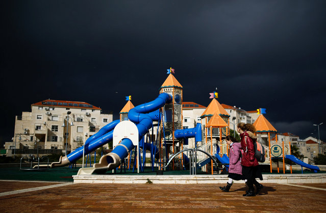 Girls walk in a playground on a stormy day in the Israeli settlement of Beitar Illit in the occupied West Bank February 15, 2017. (Photo by Amir Cohen/Reuters)