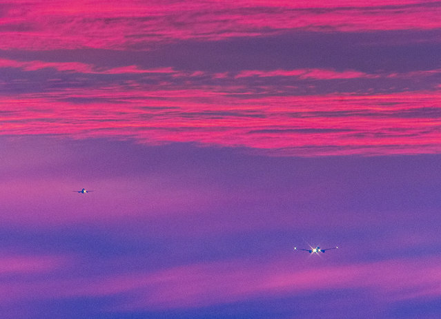 Two aircrafts approach the international airport in Frankfurt, Germany, as the sun rises on Wednesday, August 28, 2019. (Photo by Michael Probst/AP Photo)