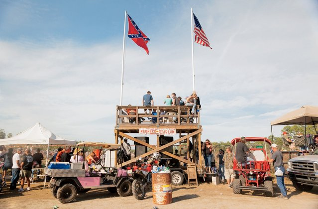 "The name ""Redneck Stadium"" is the creation of Daniel Patrick Hoolihan, IV, who defines rednecks as ""people who would probably be having more fun than others"". He and his wife, Dawn, have been attending the races for 25 years. (Photo by Malcolm Lightner)"