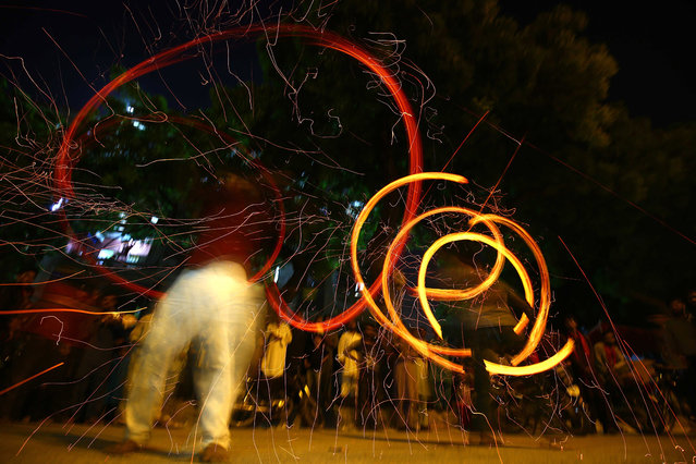 Pakistani Shiite Muslims play with a fire ball during an Ashura mourning procession, during the Islamic sacred month of Muharram in Karachi, Pakistan, 10 September 2019. Shiite Muslims are observing the holy month of Muharram, the climax of which is the Ashura festival that commemorates the martyrdom of Imam Hussein, a grandson of the Prophet Mohammed, in the Iraqi city of Karbala in the seventh century. (Photo by Shahzaib Akber/EPA/EFE)