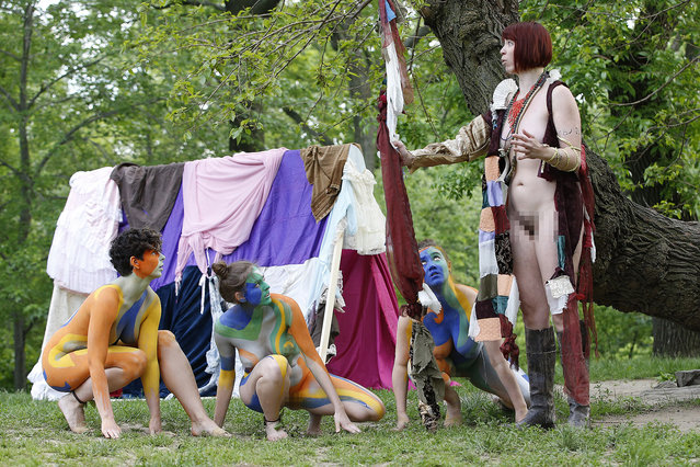 "Gina Marie Russell, right, is ""Prospero"", during the Outdoor Co-Ed Topless Pulp Fiction Appreciation Society theater company's production of Shakespeare's ""The Tempest"", Thursday, May 19, 2016, in New York's in Central Park. (Photo by Kathy Willens/AP Photo)"