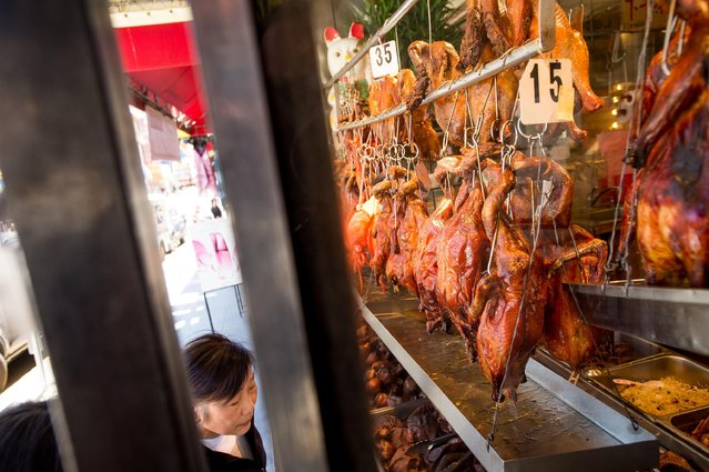 In this June 24, 2015 photo, roasted meats hang in the window of Yee's Restaurant in San Francisco's Chinatown. The neighborhood is the birthplace of Chinese America, and to some extent, the broader Asian America that descended from immigration over the Pacific Ocean throughout the 19th and 20th centuries. (Photo by Noah Berger/AP Photo)