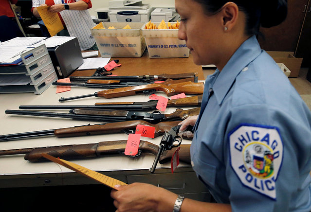 "A Chicago Police officer prepares to inventory a hand gun turned in from the public as part of the ""Gun Turn-in"" event where a gift card is given for every firearm turned over to the police in Chicago, Illinois, U.S. May 28, 2016. (Photo by Jim Young/Reuters)"