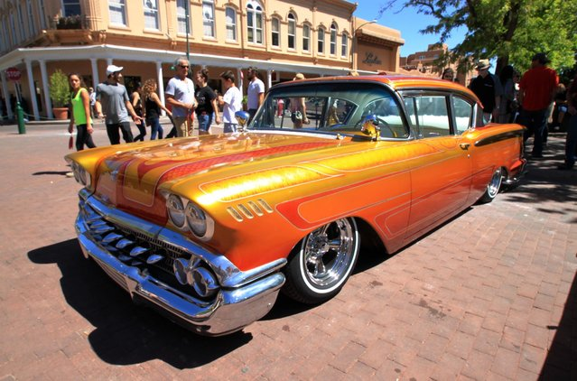 This May 22, 2016 photo shows one of the dozens of lowriders on display at the historic plaza in downtown Santa Fe, N.M., as part of the city's Lowrider Summer celebration, which includes a pair of exhibitions at the New Mexico History Museum and the New Mexico Museum of Art. (Photo by Susan Montoya Bryan/AP Photo)