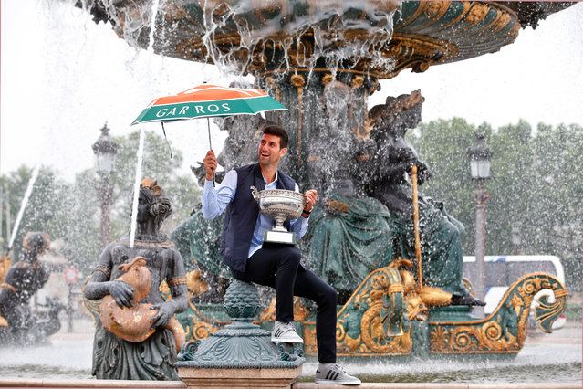 Novak Djokovic, from Serbia, poses with the French Open tennis trophy during a photo session at the Place de la Concorde, in Paris, Monday June 6, 2016. Djokovic was the winner against Britain's Andy Murray in four sets 3-6, 6-1, 6-2, 6-4. (Photo by Thibault Camus/AP Photo)