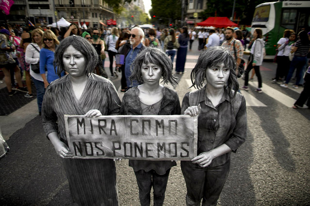 """A trio of women hold a sign with a message that reads in Spanish: """"See how we end up"""", during a demonstration commemorating International Women's Day, in Buenos Aires, Argentina, Friday, March 8, 2019. Latin Americans took the streets on Friday to shout louder than ever against male violence and show their determination to conquer free, safe and free abortion. (Photo by Natacha Pisarenko/AP Photo)"""